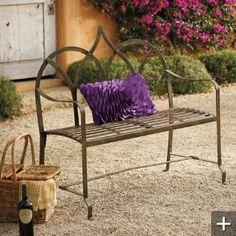 iron bench in brown ...would love this for various garden walkway seating.