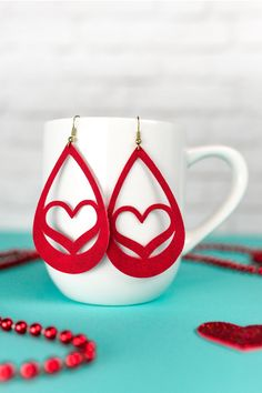 Use your Cricut to make these trendy faux suede earrings—sweet hearts that are perfect for Valentine's Day. An easy Valentine's Day jewelry project.