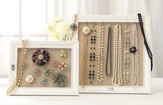 Jewelry Frames. Stand up or hang on wall. Frame burlap or cork as functional background and add hooks inside the top in matching frames. Sort jewelry by style: pearls, silver, gold - then by type: broach, earring, bracelets, rings, necklaces (by length: longer length = longer frame)