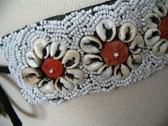 White Cowrie Shell Coral Bead White Seed Bead Tie Belt. $25.99, via Etsy.