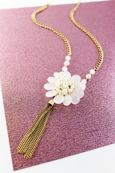 There's just something so sweet and fun about this floral tassel necklace!