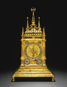 A gilt-metal quarter striking astronomical table clock, Augsburg, circa 1600 4¼-inch principal dial with silvered chapter ring numbered I-XII twice and enclosing an astrolabe with named stars and zodiac ring, engraved reversible typanum for latitudes 45 and 48 degrees, dragon hand, two small subsidiary dials above for twelve/twenty four hour striking and regulation, the lower corners with larger dials for Dominical letter and Epact number and alarm setting and indication