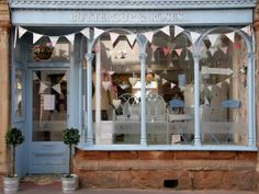 All it takes is a bit of bunting to make YOUR store front a cute store front