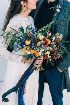 A mixture of warm and cool colours in this wedding bouquet.