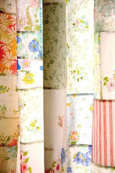 Patchwork curtain made from vintage fabrics. This would make a pretty kitchen or dining room panel or window topper.