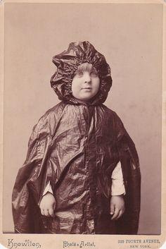 Vintage photograph. Portrait in wet weather clothes.