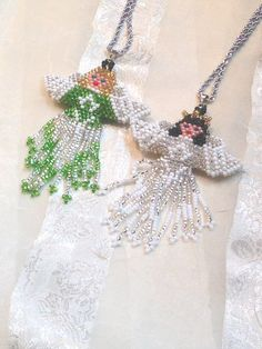 Upcycled Guardian Angel Necklaces by NorthCoastCottage on Etsy, $29.00.
