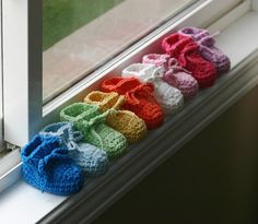 adorable knit baby booties in every colour of the rainbow!