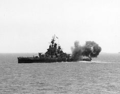 USS Nevada, resurrected from Pearl Harbor, bombards Germans at Utah Beach during the D-Day landings.