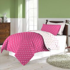 This cute comforter set offer a white background with pink polka dots on one side and a pink background with white dots on the other. Crafted of quality polyester, this set is conveniently machine washable.