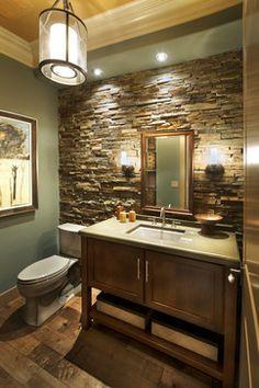 Rustic stone wall with grey bathroom vanity. Beautiful!