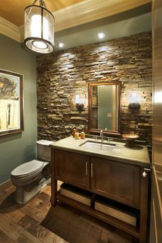 Rustic stone wall with grey bathroom vanity. Beautiful!