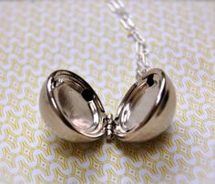 Silver Orb Locket...very cute, but what to put in it???