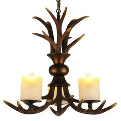 Savor the natural beauty with this antique resin antler black metal 3-light frosted cylinder glass shade chandelier.