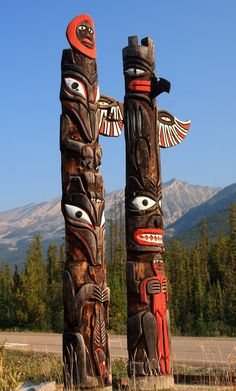 """""""Totem poles near the Sunwapta Falls turnoff"""" by Alaskan Dude on Flickr - The photographer spent a few days in Jasper National Park in Alberta, Canada.  He stated that Jasper is incredibly gorgeous.  This photo depicts totem poles near the Sunwapta Falls turnoff."""