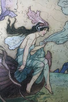 FAIRY BOAT Handcut wooden jigsaw puzzle by Bella Puzzles. 100+ pieces. 6.25 x 10 inches. Several figural pieces. Artwork by Warwick Goble.