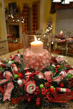 Peppermint centerpiece with wreath around base, add ornaments and ribbon.