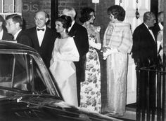 6/5/1961-London, England- Waiting for cars to go to Buckingham Palace fr dinner with Queen Elizabeth, Preisdent Kennedy's entourage appears to be conscious of the history of the moment. It will mark the first time that a President has dined at the Palace since 1918. Present are (left to right): President Kenndy, Dean Rusk, Jackie Kennedy, David K. Bruce (hidden), Mrs. Bruce, Eunice Shriver and Prince Radziwill.   June 5, 1961