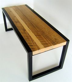 Bench made from reclaimed wood and welded metal. Painted black and stained with a natural wood color.