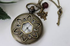 Alice in Wonderland - Vintage Filigree Flower Pocket Watch Necklace with Key and Rabbit CharmFavorite  Like this item?    Add it to your favorites to revisit it later.  Alice in Wonderland - Vintage Filigree Flower Pocket Watch Necklace with Key and Rabbit Charm