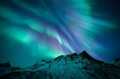 Motind © Rune Engebo (Norway) Living in Norway, the photographer had seen his fair share of aurorae, but on 21 January 2015 he witnessed the strongest variety of colours he had ever set eyes on in this beautiful explosion of purples and greens. Careening over the peaks of Senja, oxygen produces the greens and nitrogen the purples, seen in this particular display of the Northern Lights.