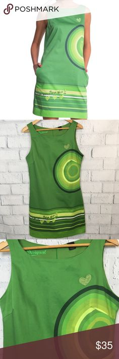 """Desigual Say Something Nice Green Cotton Dress m FUN Desigual Green Cotton Dress 🌿with Pockets! Lovely writing """"Say Something Nice"""" at the bottom Front ❤️  Tiny snag as shown in photo  Size 44  Approx Measurements taken flat:  Chest pit to pit 19 1/2 Front Length 31 3/4 Back Length 33 Desigual Dresses"""