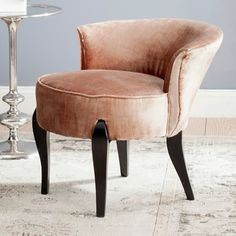 Signaling the return to glamour, the Mora vanity chair by Safavieh conjures images of Hollywood dressing rooms.