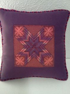 Needlepoint pillow inset St. Margaret's Star by Carole Lake is in an issue of Needlepoint Now.