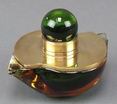 "Lot 34, A Studio Glass gilt mounted free form inkwell 5 1/2"", est £30-60"