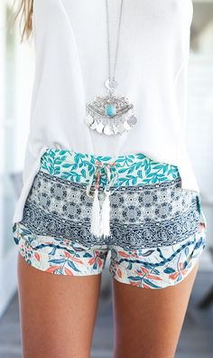 Printed Flow Shorts with Baggy White Shirt and Necklace.