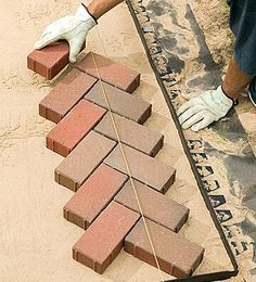 Amp Up Your Yard by Laying a Herringbone Brick Pattern Brick Pathway, Paver Walkway, Brick Pavers, Brick Flooring, Herringbone Brick Pattern, Paving Pattern, Patio Patterns Ideas, Brick Sidewalk, Earth Bag Homes