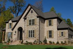 Brick offers unlimited colors and styles to fit any personality. This home features stack bond framed openings with semicircular arches and an impressive brick staircase; the windows are framed by soldier course headers and special shape brick sills. http://insistonbrick.com/