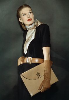 https://flic.kr/p/8SrSC4 | 1944 | Model is wearing a black dress accessorized by neutral colored items.   Image by Condé Nast Archive/CORBIS
