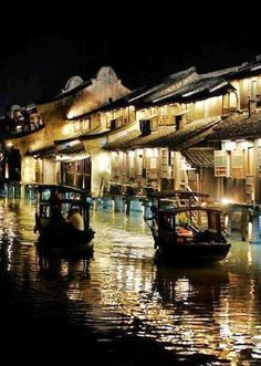 Night image of the river at Suzhou, China  Photographer ~ Xaron White