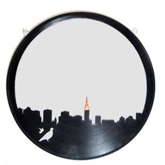 Another recycled vinyl record project, this time using a mirror to create a cityscape.