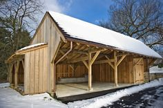 Our take on a classic Quaker carriage shed is shown here in rough-sawn mixed oak with three garage/storage bays and a hutch for firewood.
