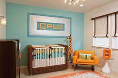 Retro modern boy's nursery by Little Crown Interiors with an aqua and orange color scheme