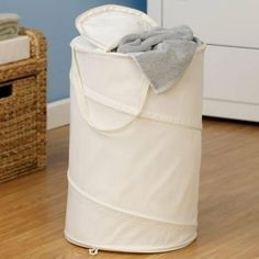 Whitney Design 2024 Poly-Cotton Natural Canvas by Whitney Designs. $19.99. Spring form steel frame pops open for quick set up.. Sturdy handles make transport easy.. Canvas hamper.. Folds flat for convenient storage.. Features a slit top for convenient loading and neat storage.. Laundry storage springs to life time and again with this multitasking pop-up canvas hamper! Its strong and flexible steel frame lets this hamper fold flat for storage and spring back to i...
