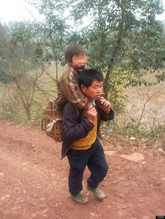 Yu Xukang, 40, a single dad from the Sichuan Province in China, walks 9 miles every day with his son, Xiao Qiang, strapped to his back so that the boy can get an education. The 12-year-old has a disorder that has caused his arms and legs to become twisted and his back to be hunched over, and there is no public transportation available to take him to class.  To support himself and his young son, Yu works as a farmer, according to China Daily.