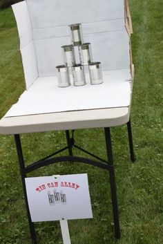 Carnival Themed Party games. Like the box idea around the cans for easy pick up