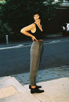 Pleated trousers with knit tank top and oxfords. Chic librarian style.