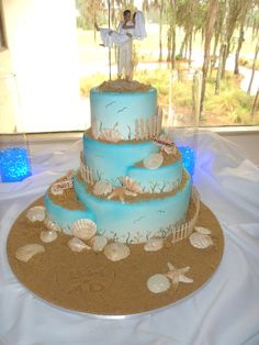 Beach Wedding Cake by CakeryCreation so neat with the half cakes on the sides!