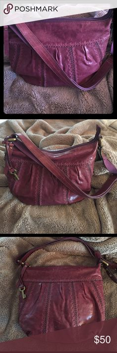 NWOT Fossil Leather Cross Body Handbag Awesome color!!! Purple/Burgundy real leather Fossil cross body bag. Never used! Perfect condition. The seams of the purse have little flower detail stamped into the leather. Adjustable straps, so it can be worn as a purse or cross body. Great, quality handbag!!Smoke free home. All reasonable offers accepted!  Bundle more and save!! Thank you!! Fossil Bags Crossbody Bags