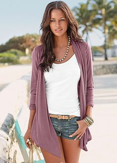 Tie it up or let it go, this cardigan gives you options! Venus two in one cardigan top.