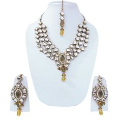 This is a beautiful 3 pcs set of Indian fashion Bollywood designer necklace jewelry set includes a necklace set with an adjustable cord, a pair of earrings, and tikka for forehead. The set is in gold tone with white & olive green acrylic crystal stones.   Designer Necklace jewelry set is commonly worn on festive occasions and marriages. This jewelry is handcrafted to excellence. This is an traditional jewelry and will add more charm to your jewe...