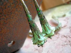 Green Elven Wands, Fairy Flower Earring, Brass Filigree Cones, Art Nouveau Style, Faery Couture, Colorful Boho Chic, Elksong Jewelry by ElksongJewelry on Etsy https://www.etsy.com/listing/58070899/green-elven-wands-fairy-flower-earring