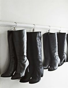 hang winter boots from a picture rail