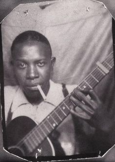I used to carry this picture of Robert Johnson around in my wallet; I can't quite remember why. Poor guy only lived to age 27.