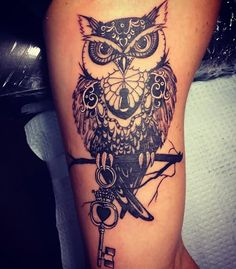 Owl Sitting On Branch With Key Tattoo