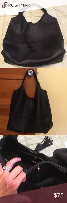 Beautiful black fringed bag This bag is brand new . It is a black big Buddha purse. It has beautiful fringe on the front .Inside it has two compartments one is a zipped area & has and lots of room  for your valuables.This is a real beauty .  original price $90 Big Buddha Bags Totes